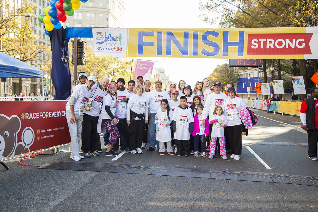 Group of people under banner for the Children's Hospital Race for Every Child in 2015